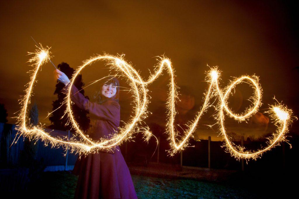 kika4811663_Woman-writing-LOVE-sparkler-1024x682