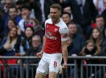 Arsenal's Welsh midfielder Aaron Ramsey celebrates after scoring the opening goal of the English Premier League football match between Tottenham Hotspur and Arsenal at Wembley Stadium in London, on March 2, 2019. (Photo by Daniel LEAL-OLIVAS / AFP) / RESTRICTED TO EDITORIAL USE. No use with unauthorized audio, video, data, fixture lists, club/league logos or 'live' services. Online in-match use limited to 120 images. An additional 40 images may be used in extra time. No video emulation. Social media in-match use limited to 120 images. An additional 40 images may be used in extra time. No use in betting publications, games or single club/league/player publications. /