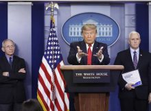 epa08325415 US President Donald J. Trump speaks as Vice President Mike Pence (R) and Director of the National Institute of Allergy and Infectious Diseases Dr. Anthony look on, during a press briefing on the Coronavirus COVID-19 pandemic with members of the Coronavirus Task Force at the White House in Washington, DC, USA, 26 March 2020.  EPA/Yuri Gripas / POOL